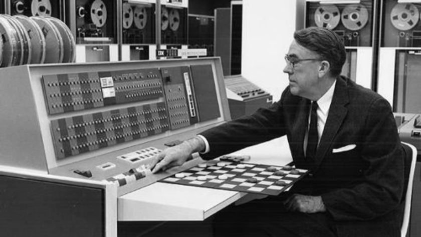 Arthur L. Samuel using an IBM 7094